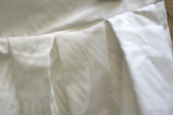 plis jupe blanche